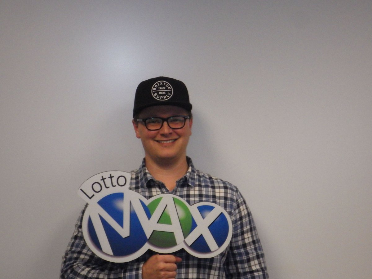 Joshua Caines claims the winning $50 million ticket from the August 30 LOTTO MAX draw.