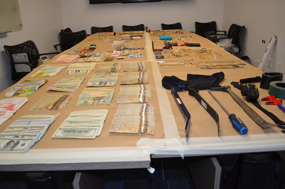 Cash, tools and jewelry police say they recovered when arresting an alleged prolific Port Coquitlam burglar.