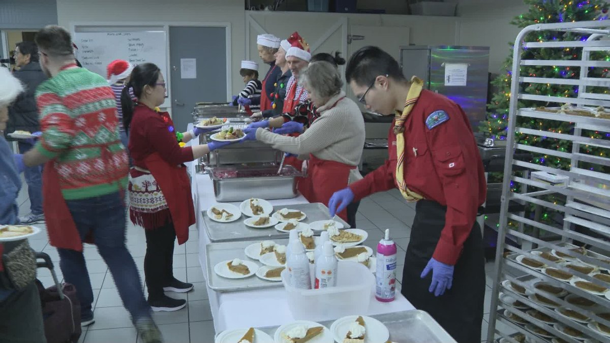 Volunteers prepare Christmas meals for those less fortunate at the Salvation Army Harbour Light in Vancouver's Downtown Eastside on Dec. 25, 2019.