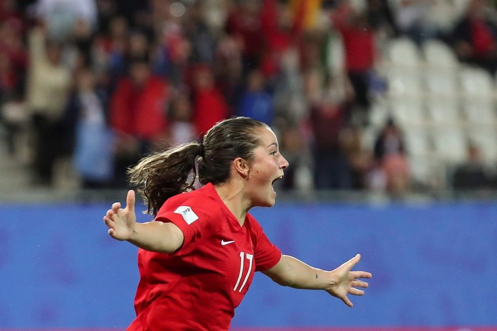 Canada's Jessie Fleming celebrates after scoring her side's opening goal during the Women's World Cup Group E soccer match between Canada and New Zealand in Grenoble, France, Saturday, June 15, 2019.