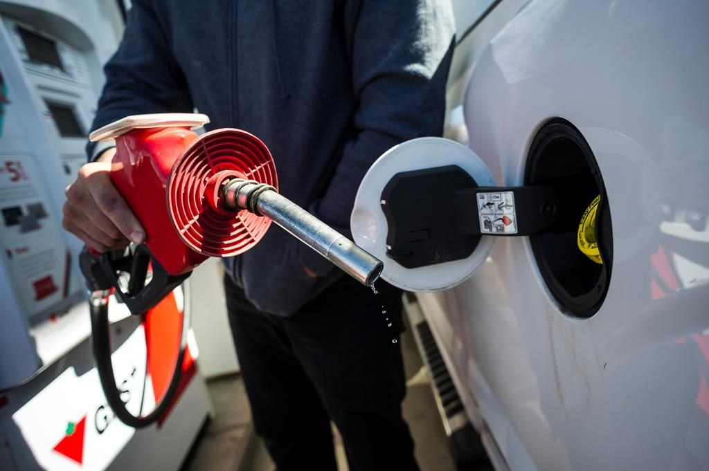 A man fills up his truck with gas in Toronto, on Monday April 1, 2019. Statistics Canada said on Wednesday, Feb. 17, 2021 the annual pace of inflation heated up in January as gasoline prices rose for the second consecutive month.