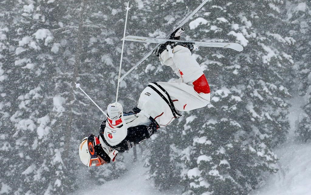 In this file photo, Mikael Kingsbury, of Canada, trains during the men's dual moguls skiing world championship, in Park City, Utah, Saturday, Feb. 9, 2019.