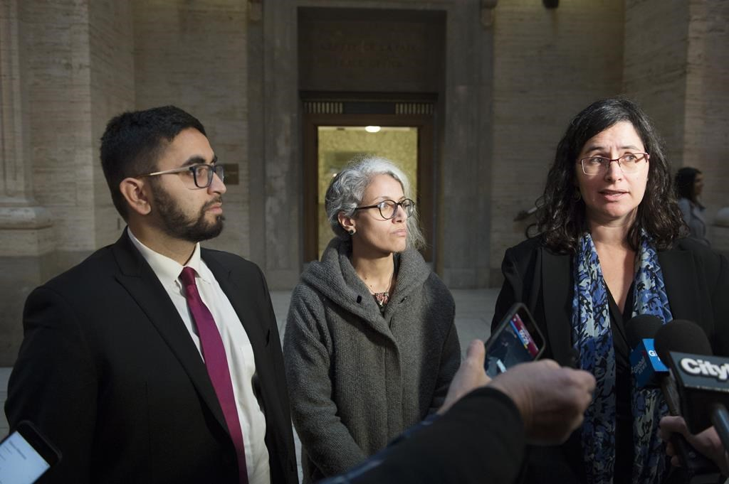 Members of the National Council of Muslims Mustafa Farooq, left, and Bochra Manai, centre, and Noa Mendelsohn Aviv a member of the Canadian Civil Liberties Association (CCLA) speak to reporters at the Quebec Court of Appeal in Montreal, Tuesday, Nov. 26, 2019.