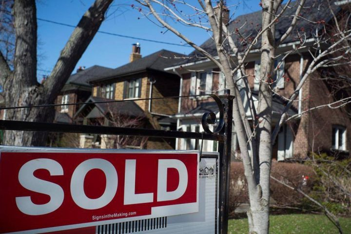 A sold sign is shown in front of west-end Toronto homes Sunday, April 9, 2017.