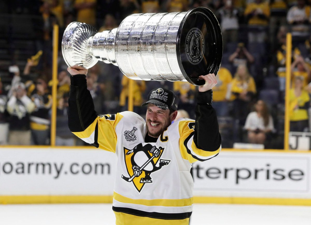 Pittsburgh Penguins' Sidney Crosby (87) celebrates with the Stanley Cup after defeating the Nashville Predators in Game 6 of the Stanley Cup Final in 2017.