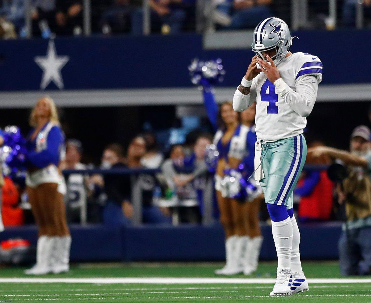 Dallas Cowboys quarterback Dak Prescott walks off the field against the Buffalo Bills at AT&T Stadium in Arlington, Texas, Nov. 28, 2019.