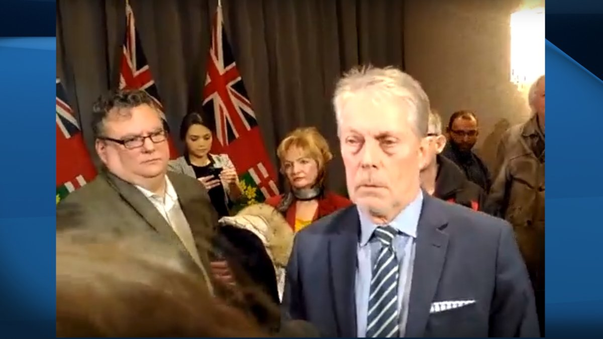 Mayor Fred Eisenberger and Councillor Brad Clark at the Sheraton in Downtown Hamilton after Ontario cancelled the city's LRT project.
