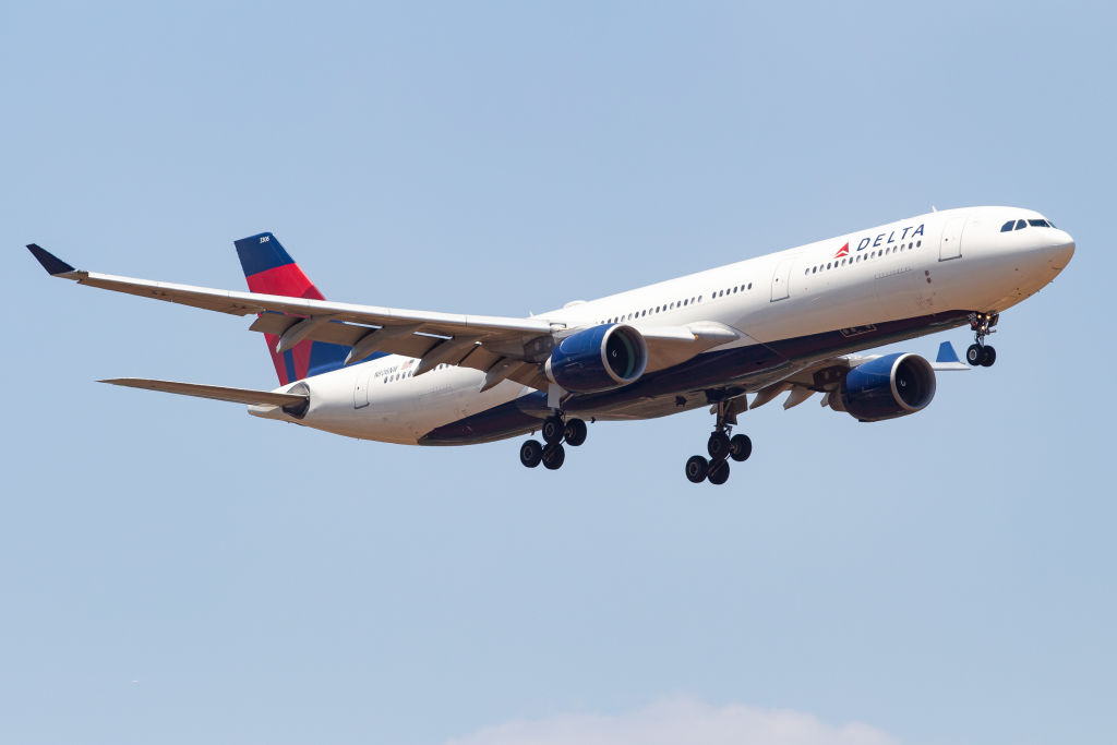 The evacuation slide from Delta Air Lines flight 405 fell into the backyard of a Boston home.