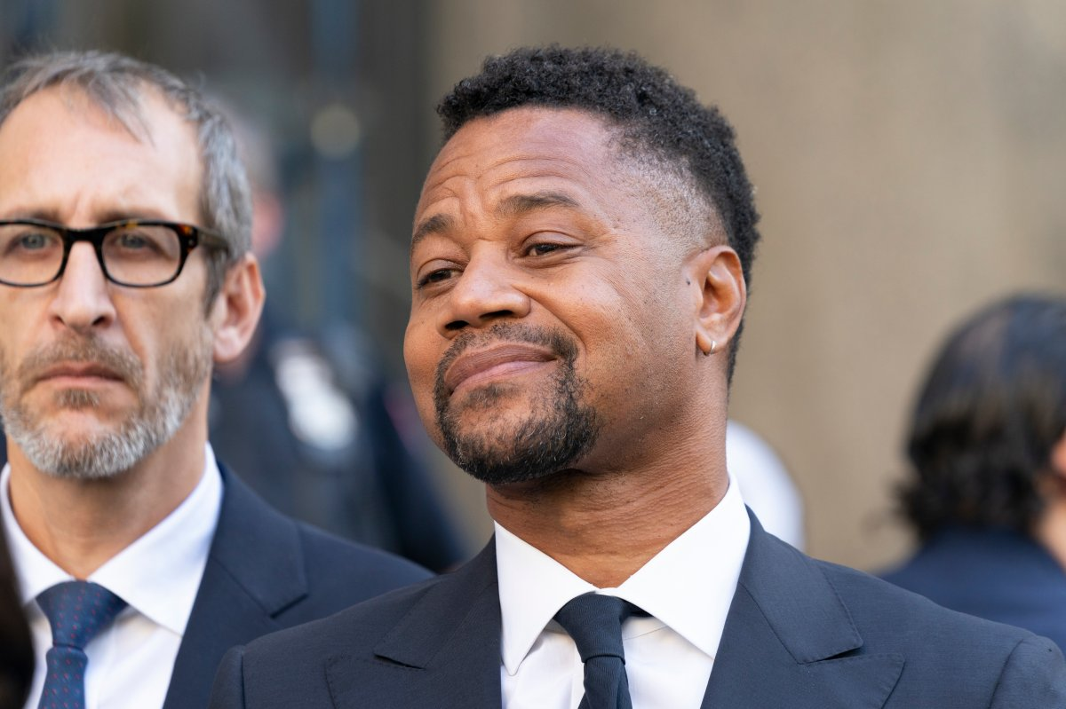 Actor Cuba Gooding Jr. listens as his attorney Mark Heller addresses press after his arraignment in New York state Supreme Court in the Manhattan.