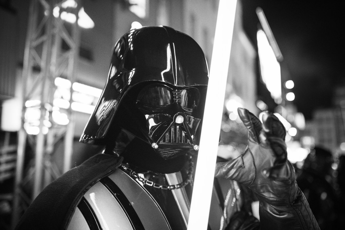 "LONDON, ENGLAND - DECEMBER 18:  (EDITORS NOTE: Image has been converted to black and white)  Darth Vader at the European premiere of ""Star Wars: The Rise of Skywalker"" at Cineworld Leicester Square on December 18, 2019 in London, England. (Photo by Gareth Cattermole/Getty Images for Disney)."