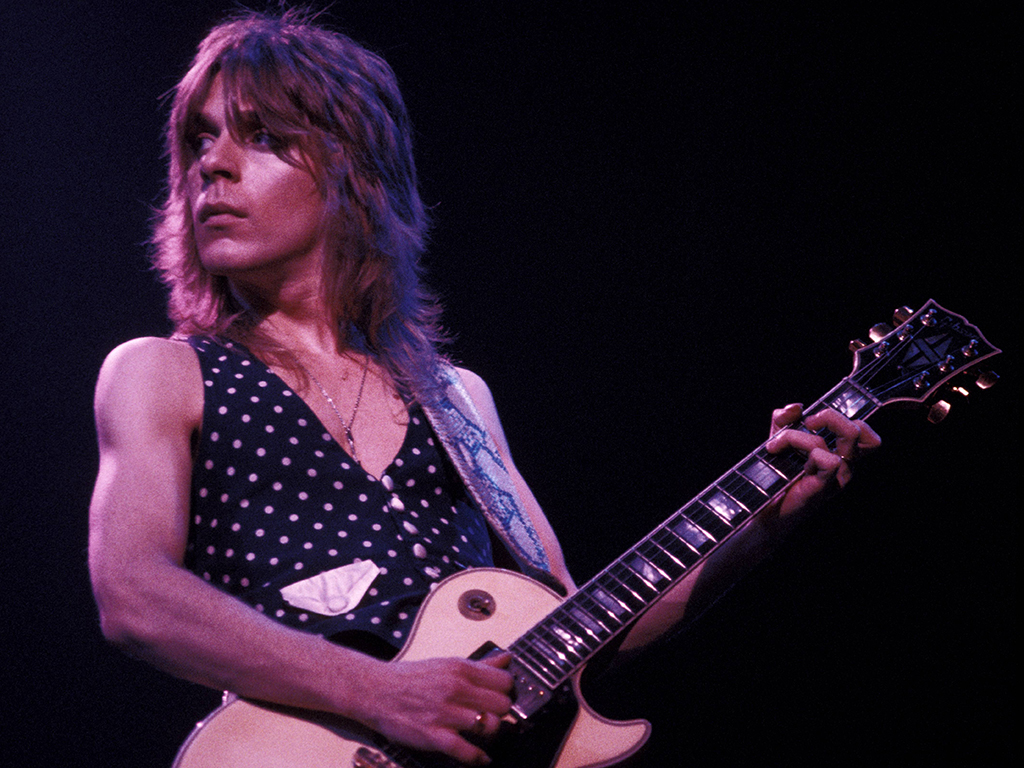 Randy Rhoads playing a Gibson Les Paul guitar, performing live onstage with Ozzy Osbourne in the early 1980s.