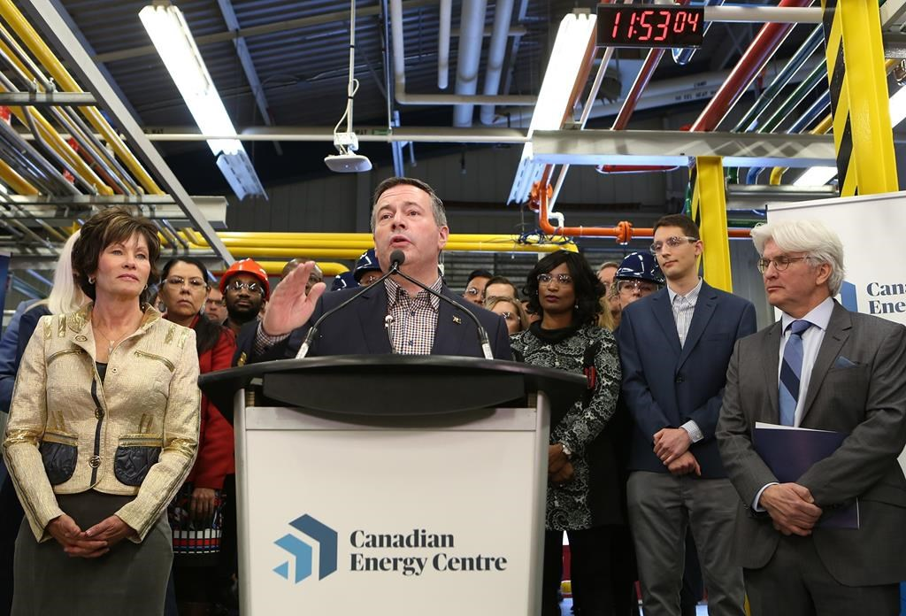 Alberta Premier Jason Kenney, centre, addresses attendees at a press conference to announce the launch of the Canadian Energy Centre at SAIT in Calgary, Alberta Wednesday, December 11, 2019.