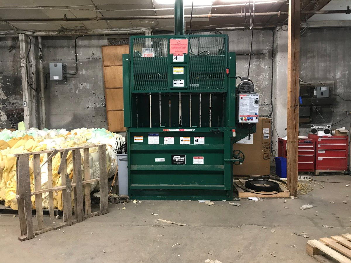 A bailer packages waste that's sent to the landfill, which only consists of five per cent of the mattress.