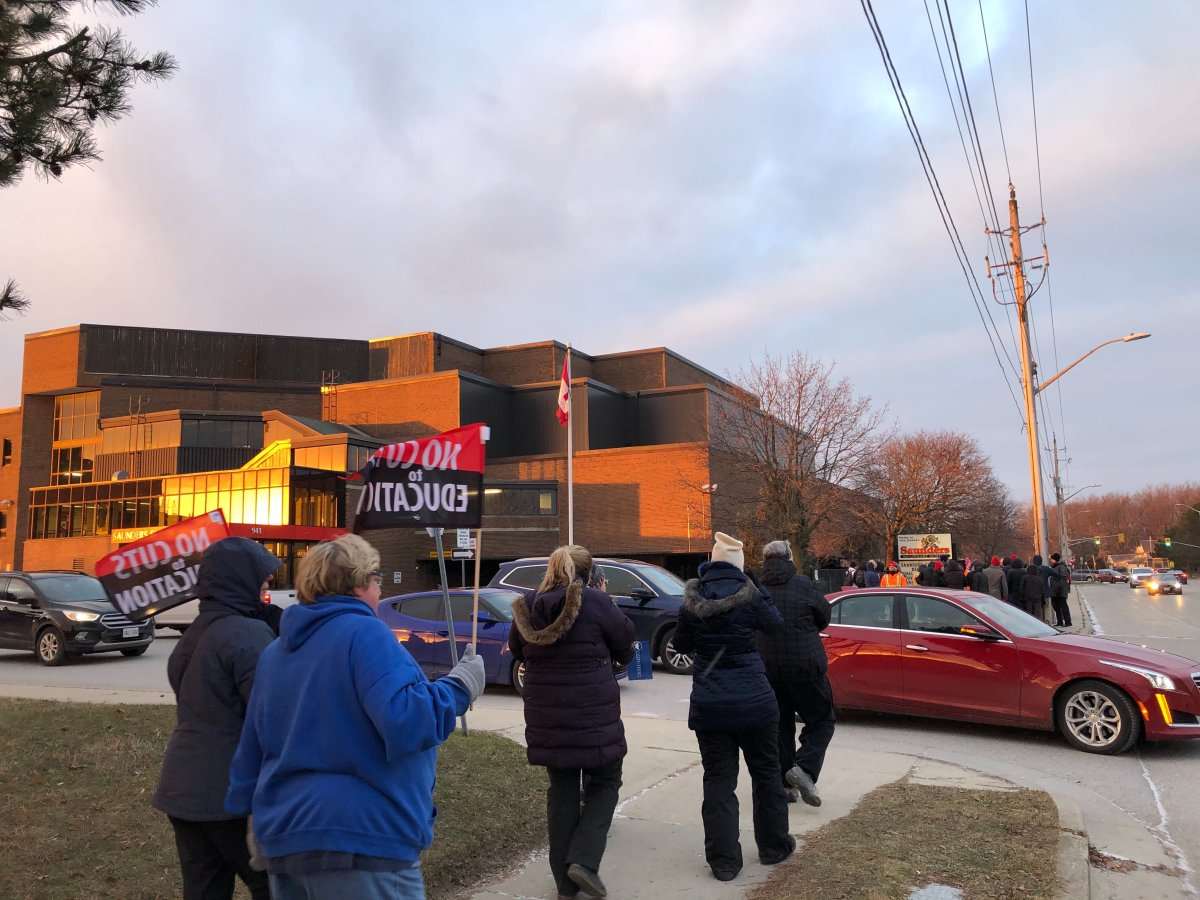 Members of the Ontario Secondary School Teachers' Federation gather for an information picket outside of Saunders Secondary School.
