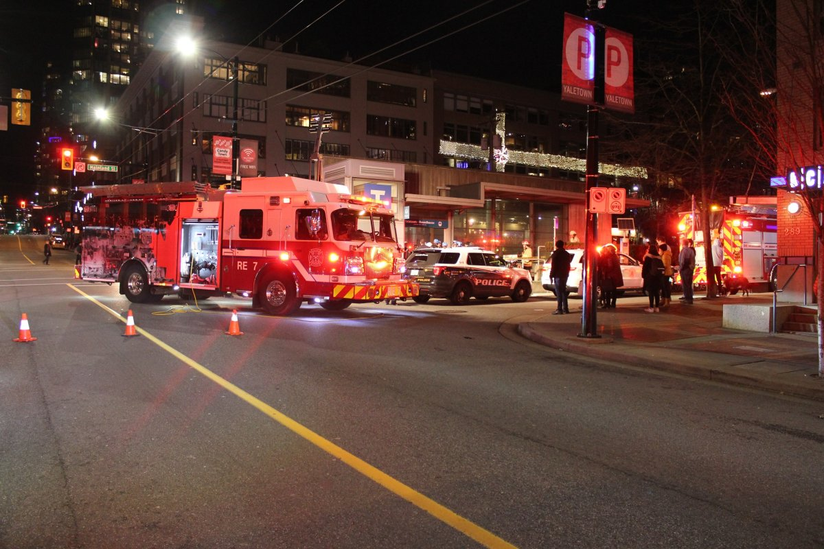First responders work to rescue a man who fell down an elevator shaft at the Yaletown-Roundhouse Canada Line station.