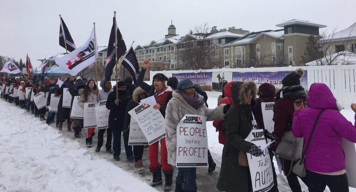 AUPE nurses rally in front of Carewest's Colonel Belcher seniors home to protest shift changes, which they say will negatively affect quality of life for nurses and residents.