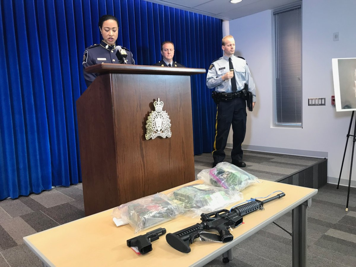RCMP and CBSA officials show off drugs, guns and cash seized as a part of a major fentanyl import bust from 2017.
