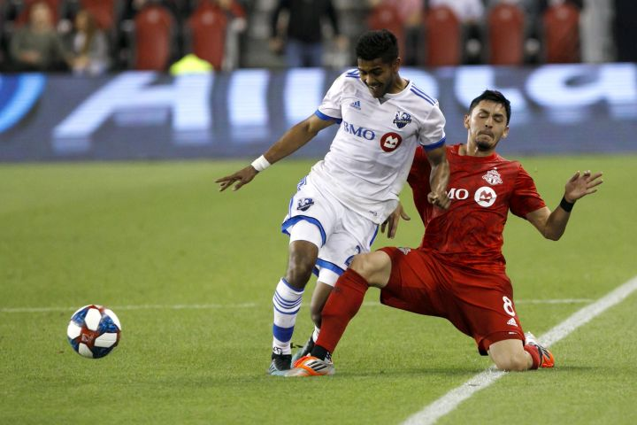 Montreal Impact midfielder Shamit Shome (28) and Toronto FC midfielder Marco Delgado (8) vie for the ball in the second half of the second leg of Canadian Champion soccer action in Toronto, Wednesday, Sept. 25, 2019.