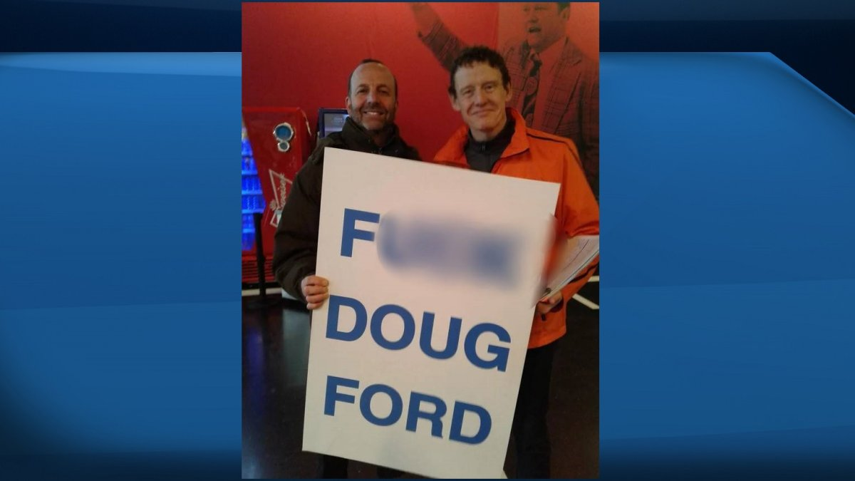 In a photo taken in Ottawa, MPP Joel Harden is seen posing with a man holding a vulgar anti-Ford sign.