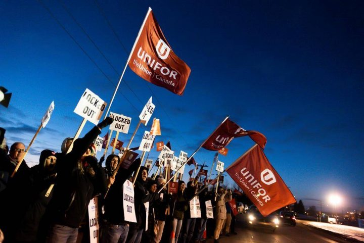 Members of Unifor Local 594 hold signs during a rally outside the Co-op Refinery in Regina on Thursday December 5, 2019.