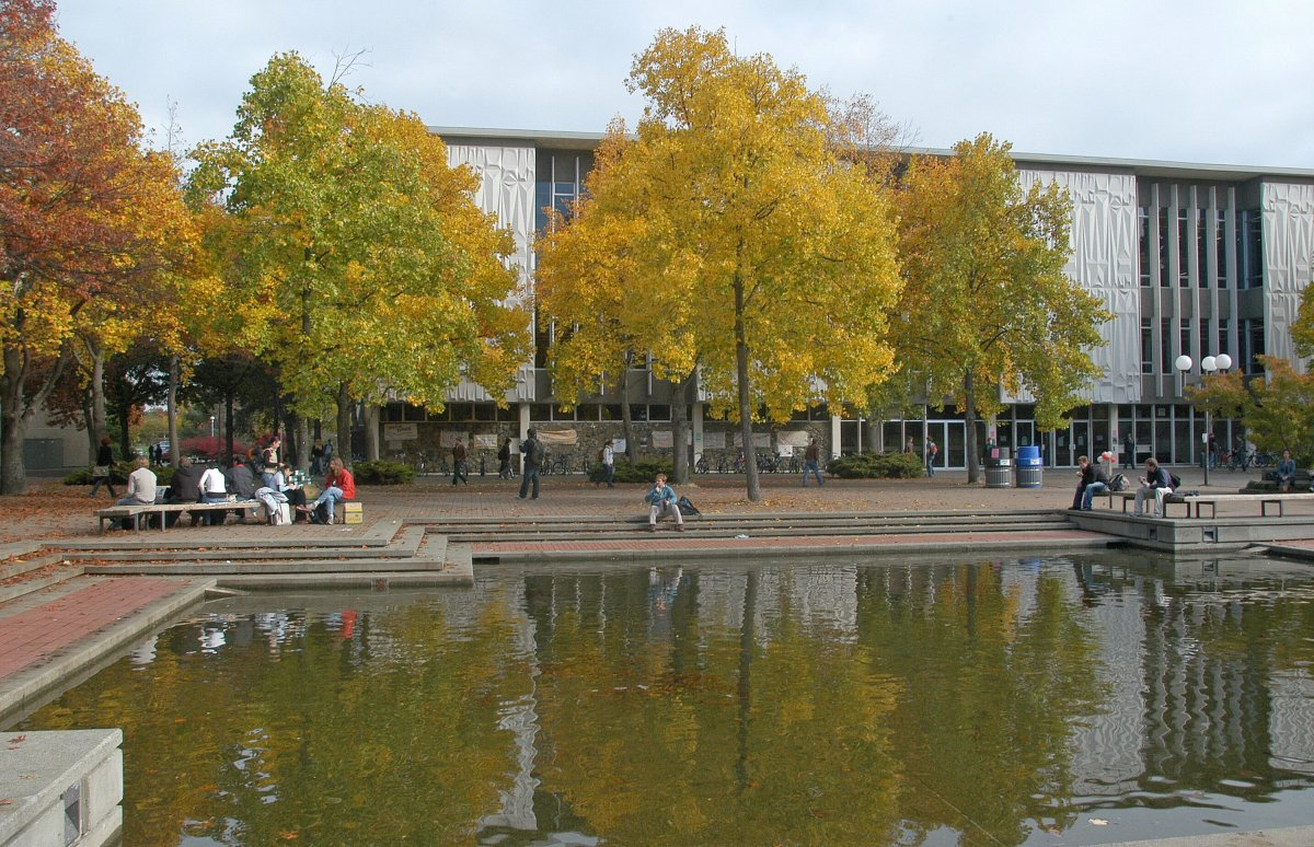 Students around the reflecting pool in front of the McPherson Library building on the University of Victoria campus in Victoria, BC.