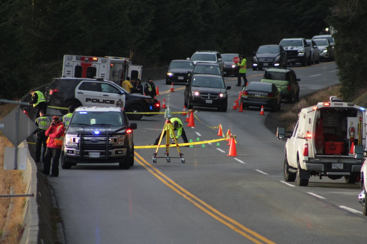 Police on scene of a collision on Cypress Bowl Road in West Vancouver on Dec. 25, 2019.