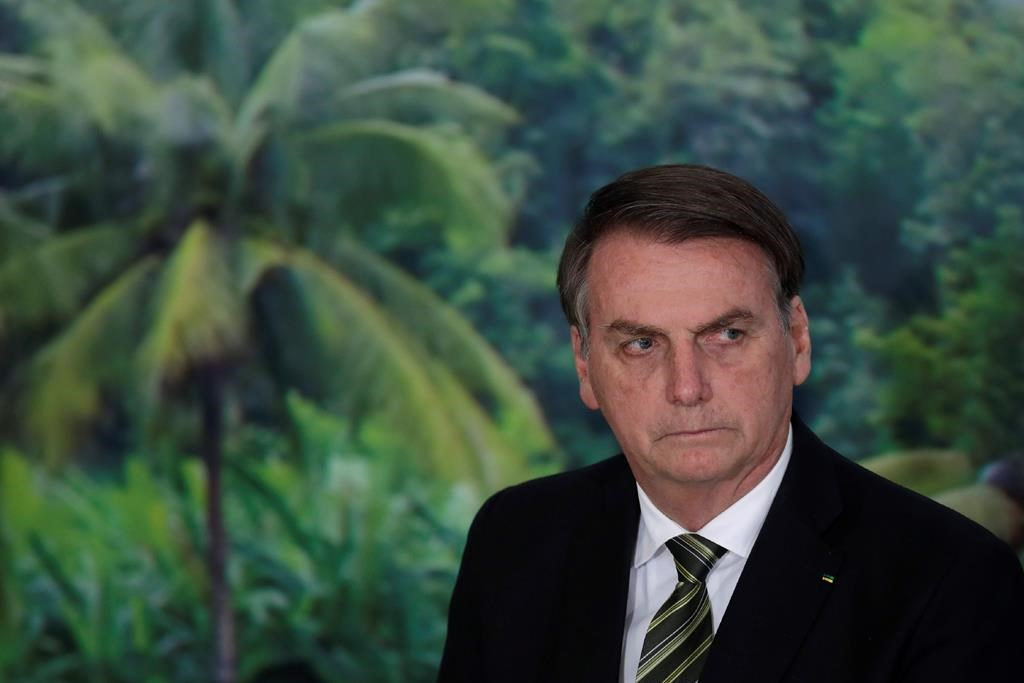 FILE - In this Oct. 1, 2019 file photo, President Jair Bolsonaro attends a ceremony to launch an agro program at the Planalto presidential palace in Brasilia, Brazil.