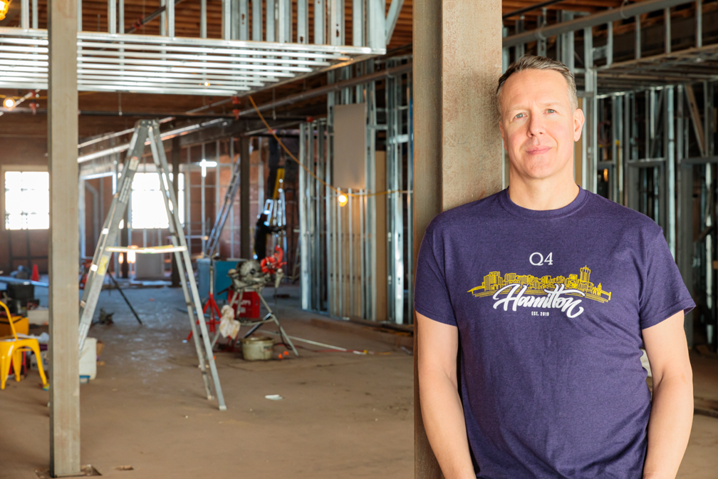 Darrell Heaps, CEO and founder of Q4 Inc., stands in the unfinished interior of the company's new office on King Street East in downtown Hamilton.