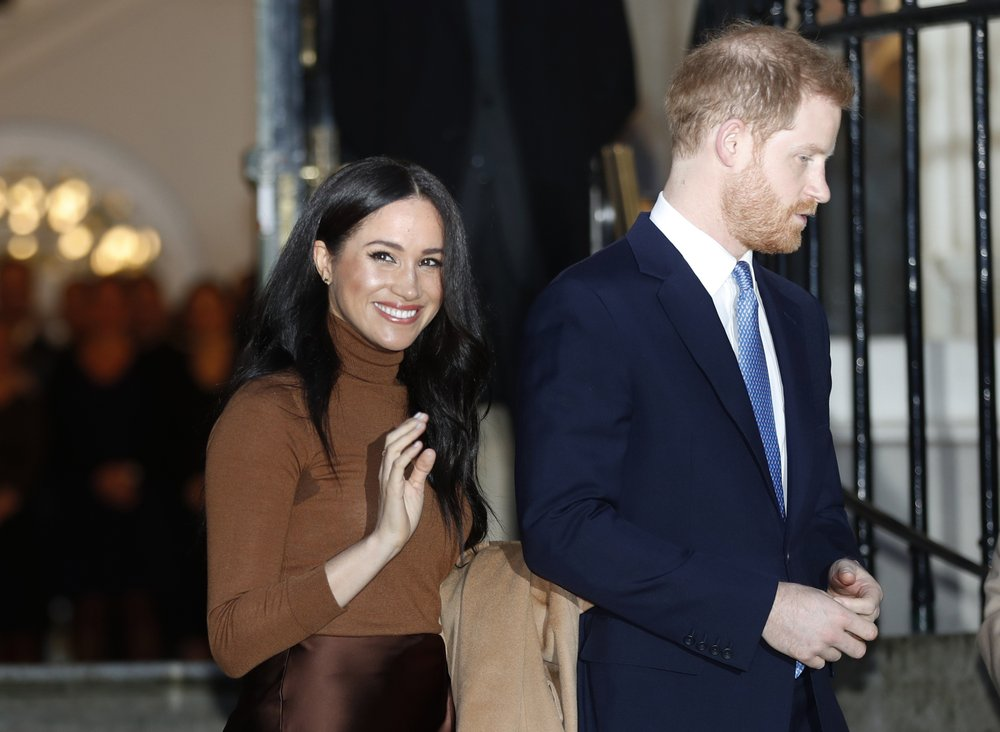 In this Jan. 7, 2020, file photo, Britain's Prince Harry and Meghan, Duchess of Sussex leave after visiting Canada House in London, after their recent stay in Canada. Prince Harry and Meghan Markle are to no longer use their HRH titles and will repay £2.4 million of taxpayer's money spent on renovating their Berkshire home, Buckingham Palace announced Saturday, Jan. 18. 2020.