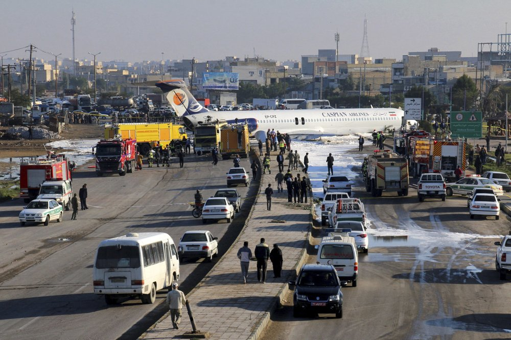 An Iranian passenger plane sits on a road outside Mahshahr airport after skidding off the runway, in southwestern city of Mahshahr, Iran, Monday, Jan. 27, 2020. An Iranian passenger airliner carrying some 150 passengers skidded off the runway and into a street next to the airport in the southern city of Mahshahr on Monday, after apparently losing its landing gear in a hard landing.
