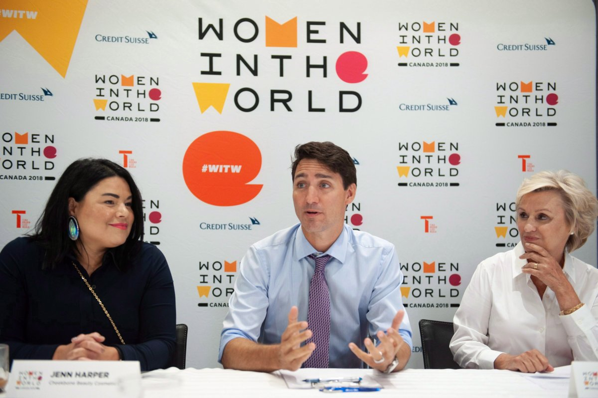 Prime Minister Justin Trudeau participates in a roundtable discussion along with Jenn Harper, left, founder of Cheekbone Beauty Cosmetics INC and Tina Brown, founder and CEO of Women in the World Media, LLC, at the Women in the World Summit in Toronto on Monday, September 10, 2018.