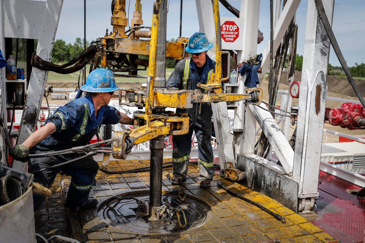 A crew on an oil rig drills for oil near Clive, Alta., Wednesday, June 5, 2019.