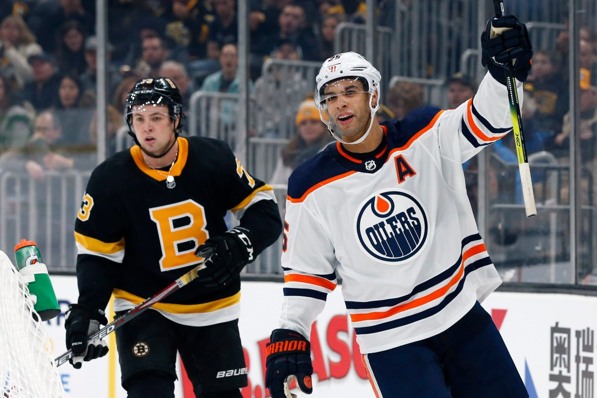 Edmonton Oilers' Darnell Nurse (25) celebrates his goal in front of Boston Bruins' Charlie McAvoy (73) during the second period on an NHL hockey game in Boston, Saturday, Jan. 4, 2020. (AP Photo/Michael Dwyer).