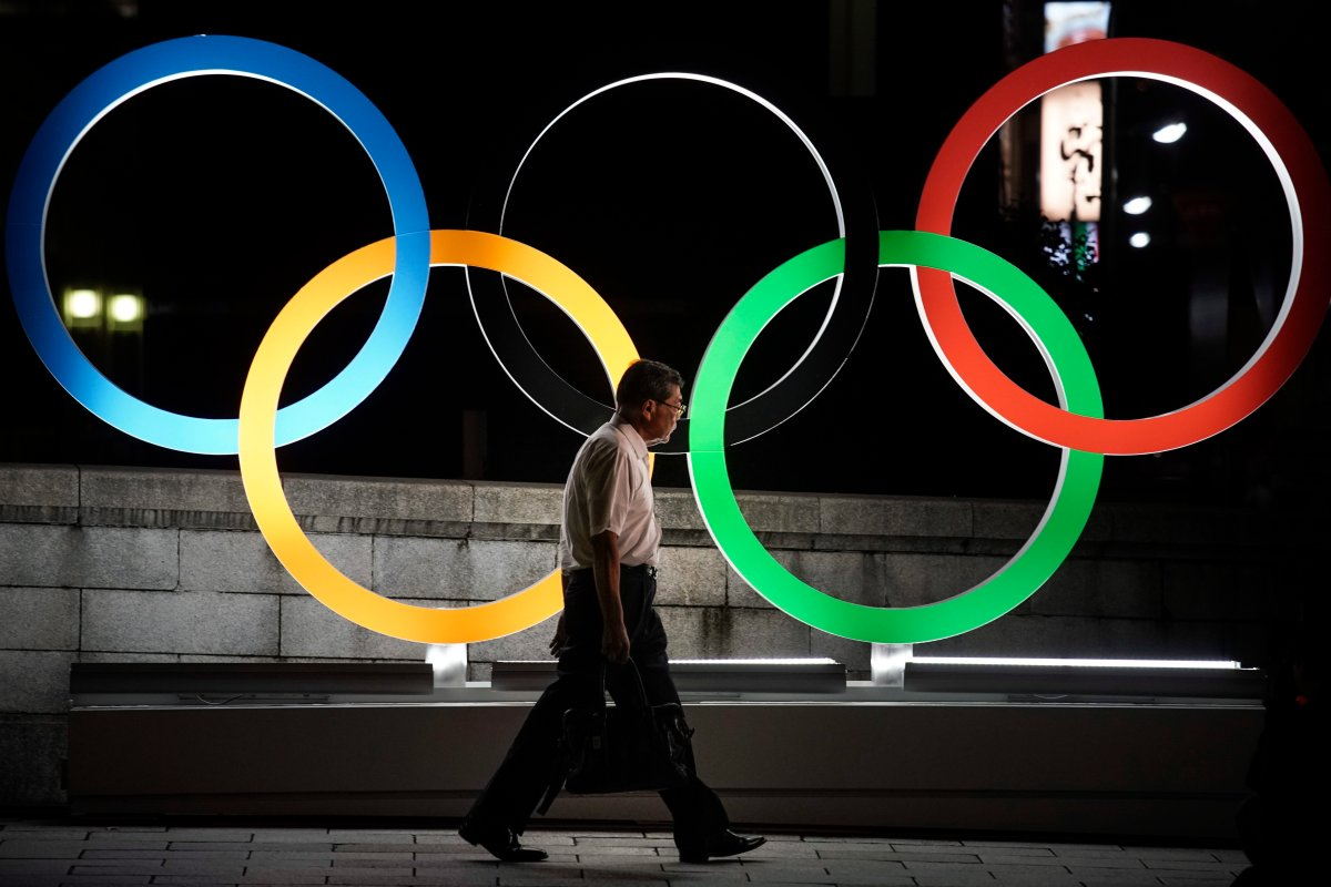 A man walks past the Olympic rings Tuesday, July 23, 2019, in Tokyo, as Japan marks a year-to-go until hosting the summer games with Olympic medals being unveiled Wednesday as part of daylong ceremonies around the Japanese capital. The Canadian Olympic Committee released its marketing guidelines Tuesday for athletes and their personal sponsors during the 2020 Olympics in Tokyo from July 24 through Aug. 9.