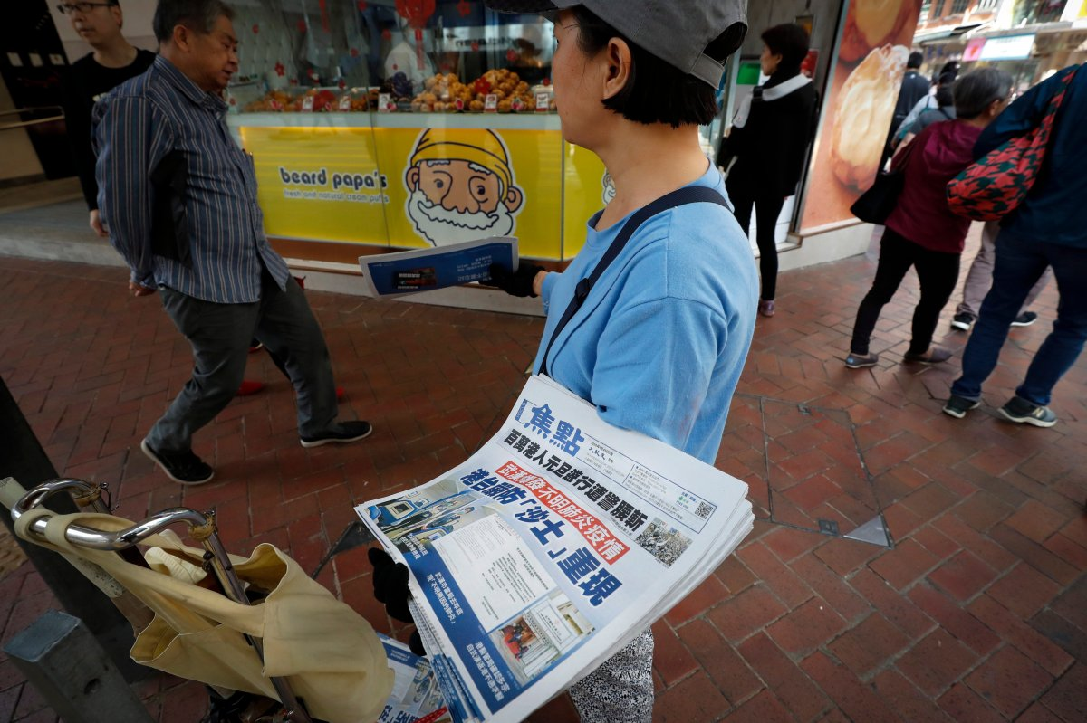 "A vendor gives out copies of newspaper with a headlines of ""Wuhan break out a new type of coronavirus, Hong Kong prevent SARS repeat"" at a street in Hong Kong, Saturday, Jan. 11, 2020. The federal Public Health Agency says it believes Canadians are at low risk of contracting a new type of pneumonia that has killed one person and has made dozens sick in central China, but it has issued a warning to travellers to and from the city of Wuhan."