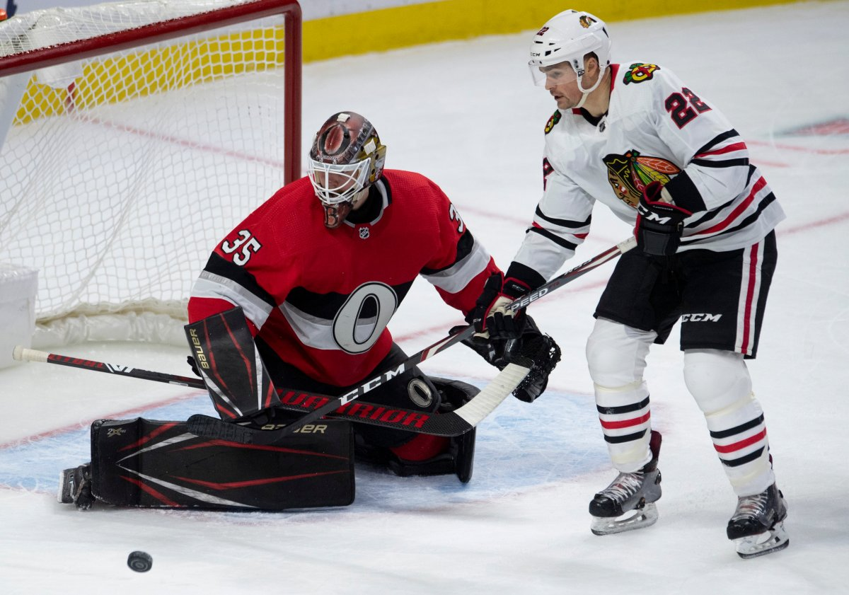 Chicago Blackhawks centre Ryan Carpenter (22) tries to corral a loose puck in front of Ottawa Senators goaltender Marcus Hogberg during second period NHL action in Ottawa, Tuesday, Jan. 14, 2020.