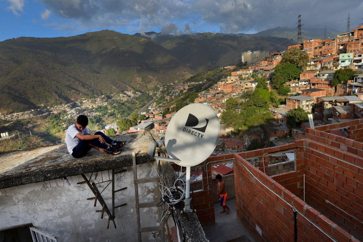 A DirectTV dish stands on home in the Catia neighborhood of Caracas, Venezuela, Thursday, Jan. 9, 2020. Venezuelan President Maduro's opponents want AT&T's DirecTV unit to restore a number of channels it was required to take down from its lineup. But forcing AT&T to do the political bidding of Maduro's foes could lead to retaliation and likely exit from a market where it has a whopping 44% market share.