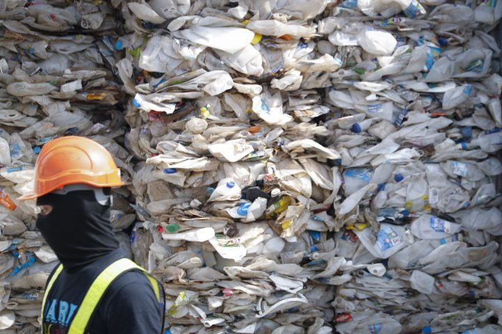 In this May 28, 2019, file photo, a container is filled with plastic waste from Australia, in Port Klang, Malaysia. Malaysia has sent back 150 containers of plastic waste to 13 mainly rich countries since the third quarter last year, Environment Minister Yeo Bee Yin said on Jan. 20, 2020.