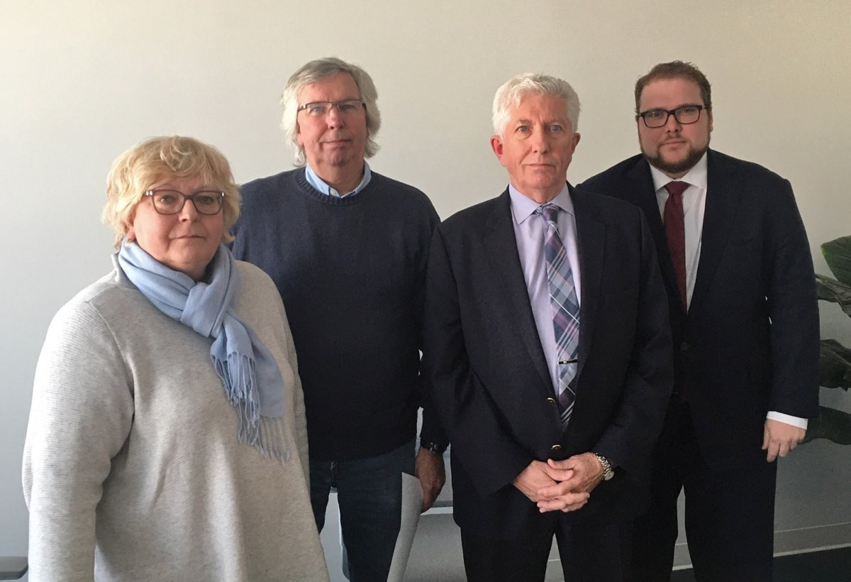 Monique Duceppe, left to right, Yves Duceppe and Gilles Duceppe pose for a photo with their lawyer Marc-Antoine Cloutier in Brossard, Que. on Monday, January 20, 2020. Helene Rowley Hotte Duceppe's seven children are suing the home where she died of hypothermia for $1.25 million.