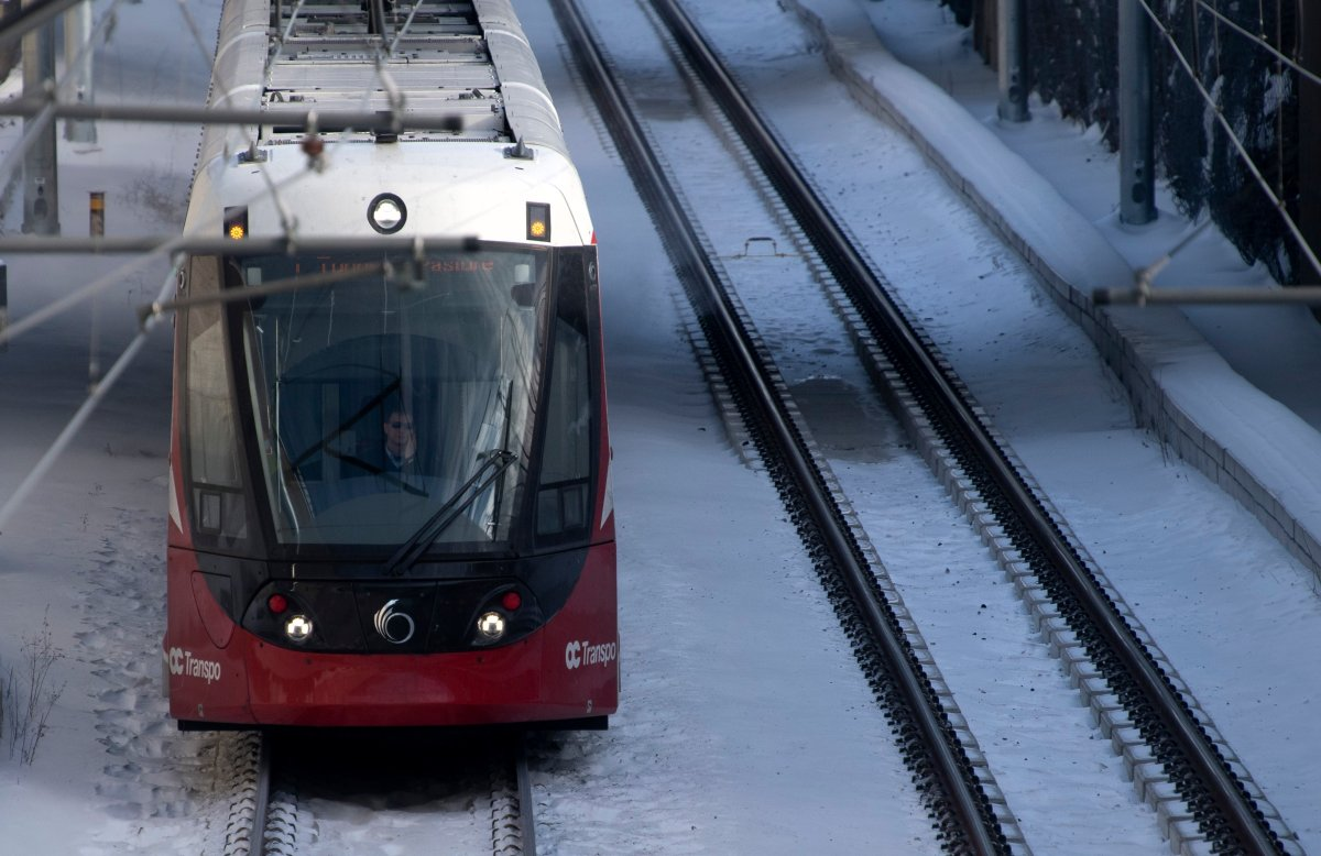 An OC Transpo light-rail train is seen heading out of downtown Ottawa on Tuesday, Jan. 21, 2020.