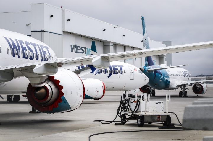 Grounded WestJet Boeing 737 Max aircraft are shown at the airline's facilities in Calgary, Alta., Tuesday, May 7, 2019. WestJet Airlines Ltd. says is removing Boeing's grounded 737 Max jet from flight schedules through June 24 following the manufacturer's latest guidance about regulatory approval for the plane to fly again.