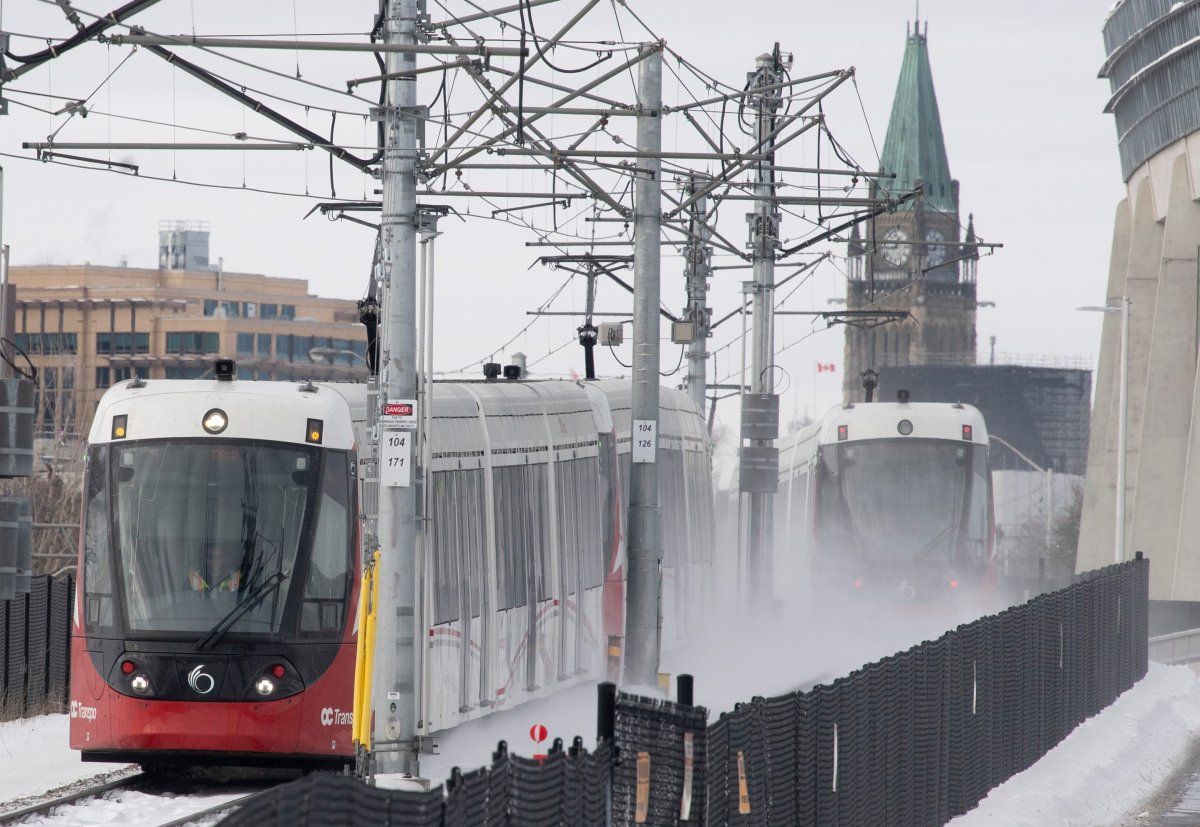 OC Transpo light rail trains pass each other near downtown Ottawa on Tuesday, Jan. 21, 2020.