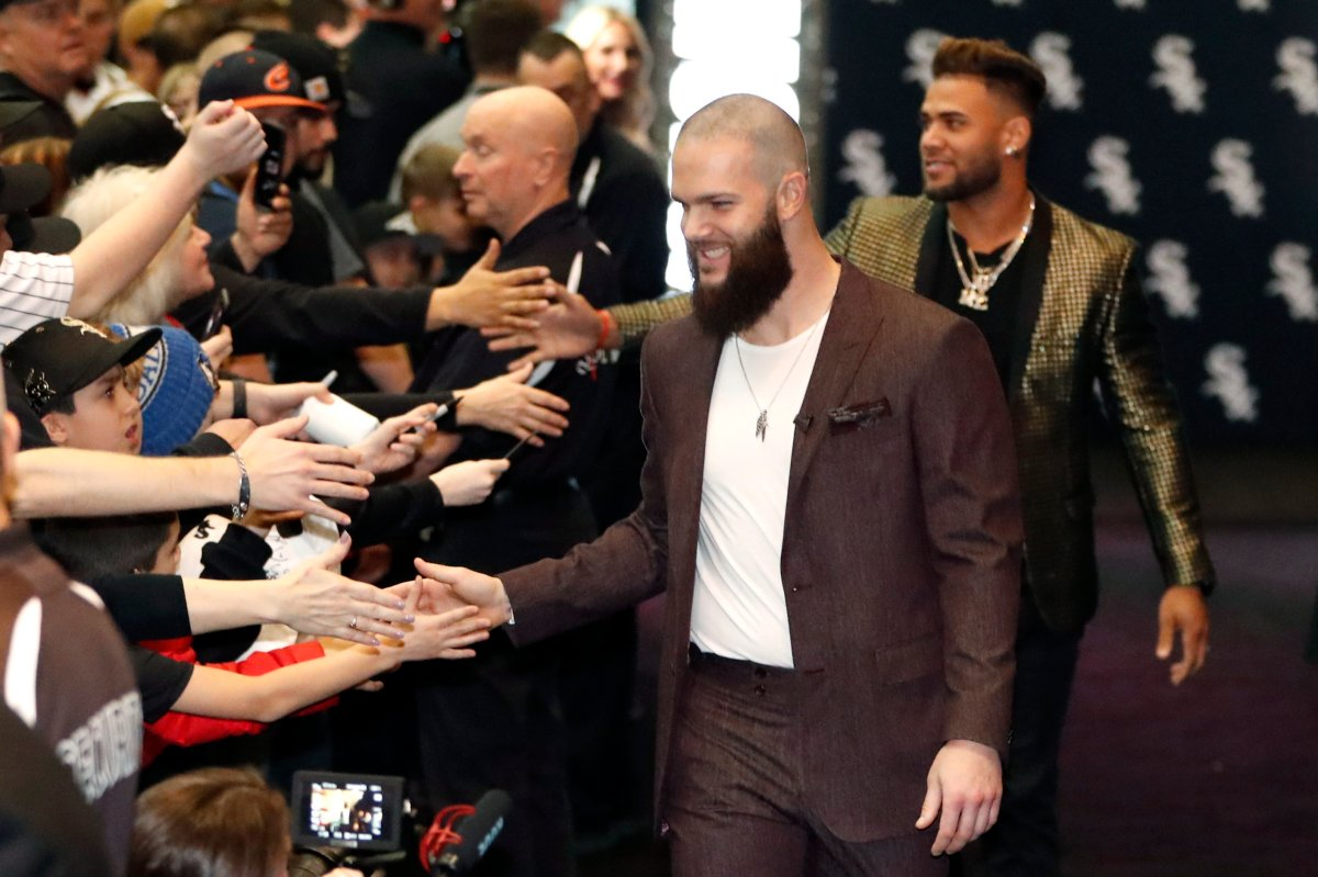 Chicago White Sox's Dallas Keuchel, center, is welcomed by fans after he was introduced during the team's annual fan convention Friday, Jan. 24, 2020, in Chicago.
