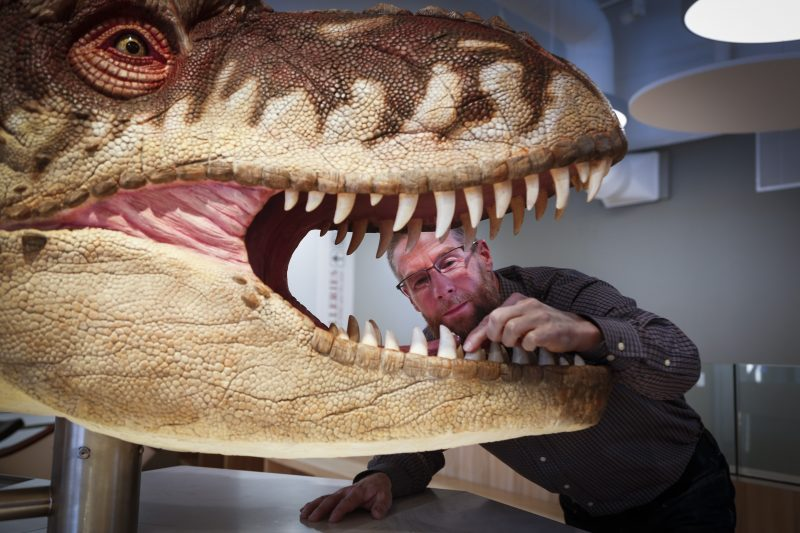 Craig Scott, Director of Preservation and Research at the Royal Tyrrell Museum of Palaeontology, checks out a hands on exhibit in the new Learning Lounge at the museum in Drumheller, Alta., Thursday, Jan. 16, 2020.