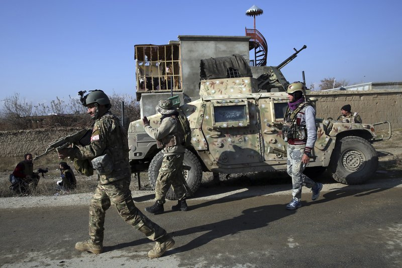 Security personnel arrive near the site of an attack near the Bagram Air Base In Parwan province of Kabul, Afghanistan, Wednesday, Dec. 11, 2019. A powerful suicide bombing Wednesday targeted an under-construction medical facility near the Bagram Air Base, the main American base north of the capital Kabul, the U.S. military said.