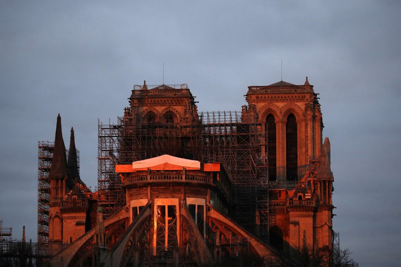 "Notre Dame cathedral is pictured when the sun rises, in Paris, Sunday, Jan. 5, 2020. Gen. Jean-Louis Georgelin who is overseeing the reconstruction of the fire-devastated Notre Dame Cathedral told French broadcaster CNews on Sunday that ""the cathedral is still in a state of peril"" after last year's fire, which destroyed its roof and collapsed its spire as the cathedral was undergoing renovations."