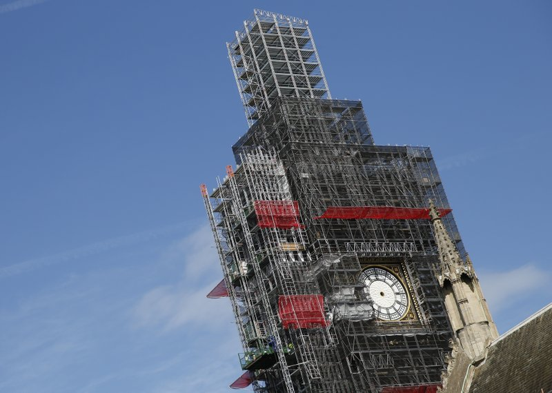 FILE - In this Tuesday, April 17, 2018 file photo, scaffolding surrounds the Queen Elizabeth Tower, which holds the bell known as Big Ben, in London.