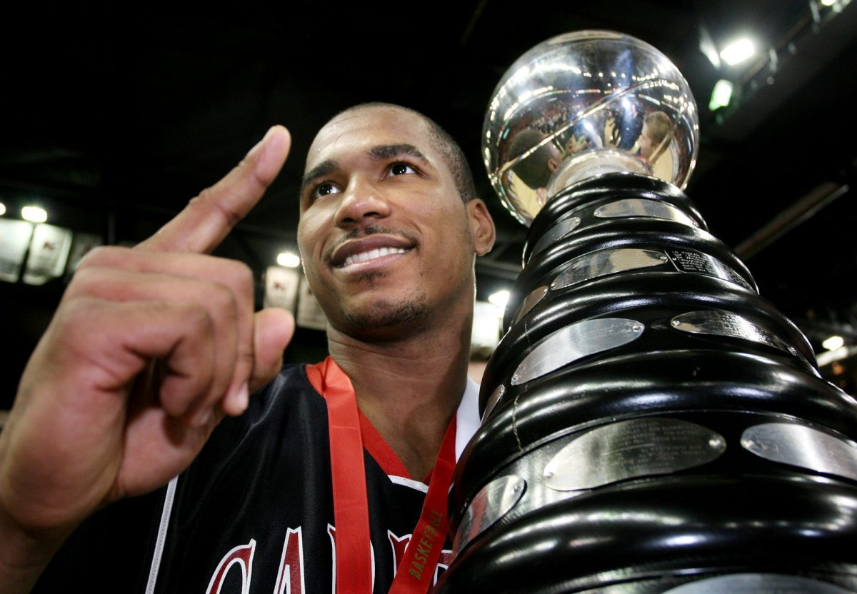 Carleton Ravens' MVP Osvaldo Jeanty, poses with the CIS basketball championship trophy at the Halifax Metro Centre on Sunday, March 19, 2006. Jeanty has been hired as the Ottawa BlackJacks' first head coach.