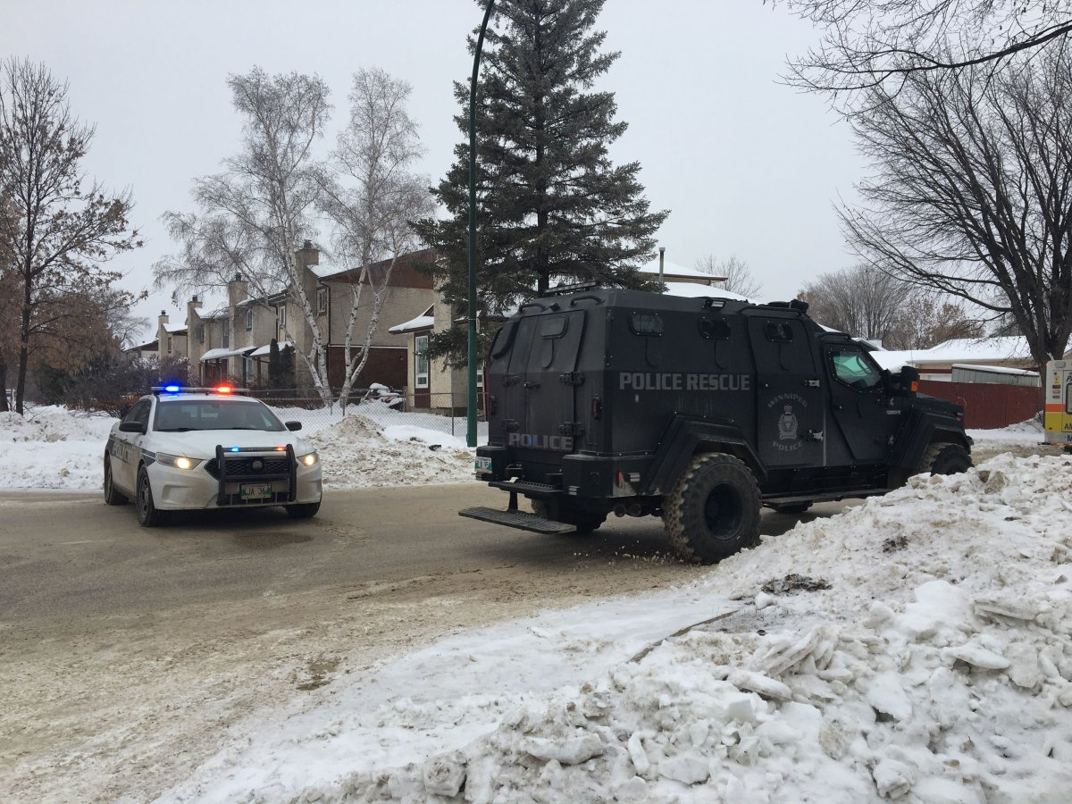 A WPS cruiser and the armoured vehicle block part of Kinver Avenue as police investigate at a home nearby.