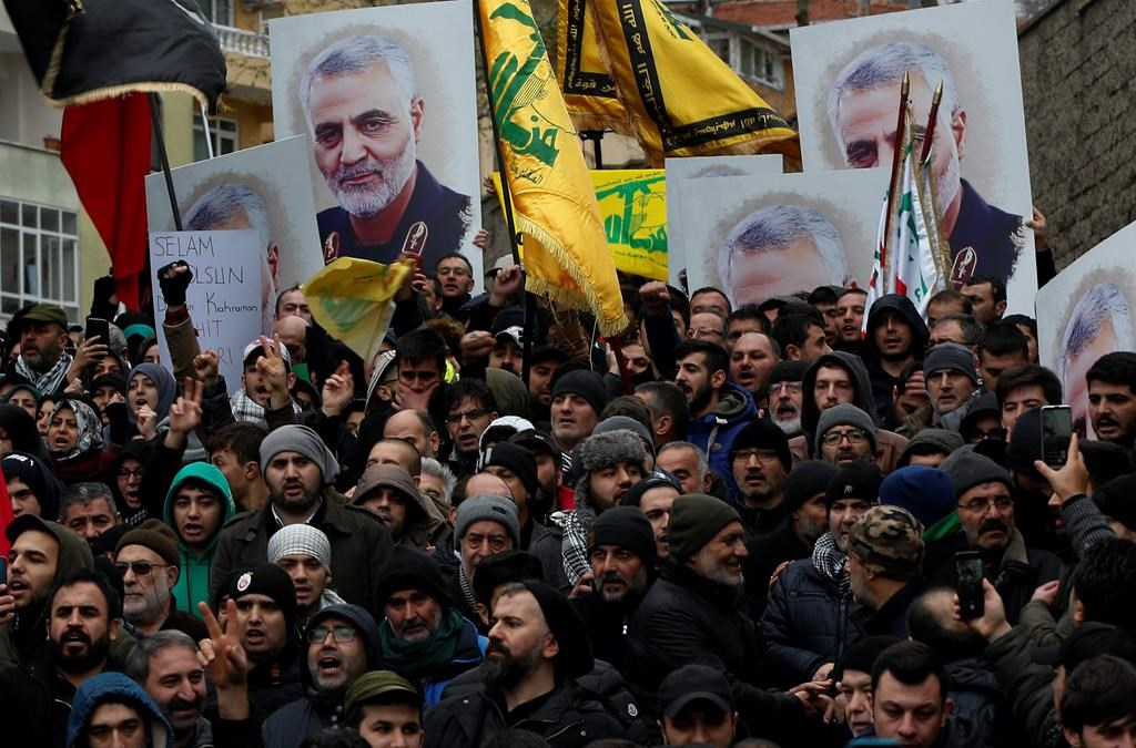 "Protesters chant anti-U.S. slogans during a demonstration against the killing of Iranian Revolutionary Guard Gen. Qassem Soleimani, close to United States' consulate in Istanbul, Sunday, Jan. 5, 2020. Iran has vowed ""harsh retaliation"" for the U.S. airstrike near Baghdad's airport that killed Soleimani, Tehran's top general and the architect of its interventions across the Middle East, as tensions soar in the wake of the targeted killing. (AP Photo/Lefteris Pitarakis)."